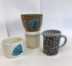 Hand painted ceramic pots and jug