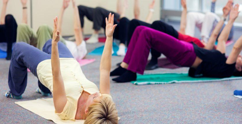 Women on lying on floor doing Pilates