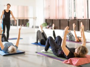 Group of women and tutor in pilates class