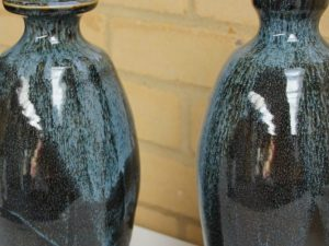 Two green ceramic vases