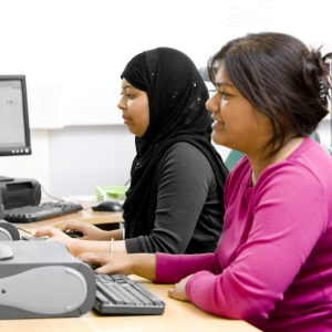 Two women working on computers