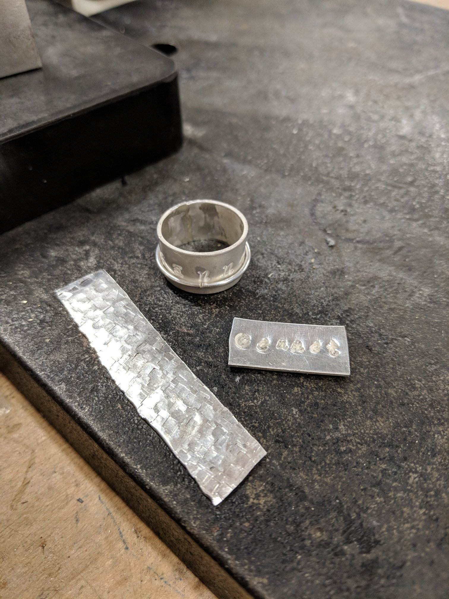 Silver ring and metal strips