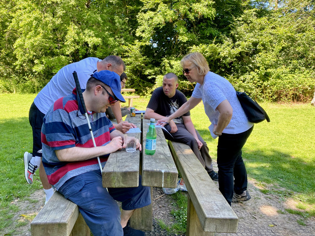 People sitting at picnic bench