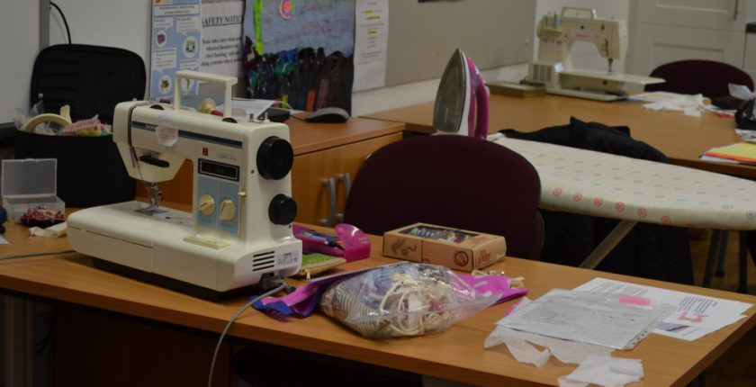 Sewing machine and ironing board