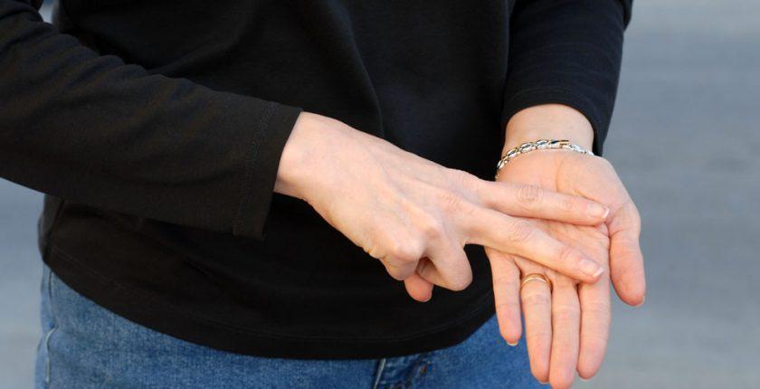Hands making sign language symbol