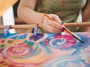 Woman painting on silk fabric