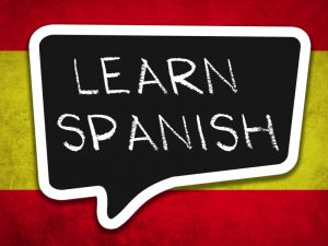Spanish flag with Learn Spanish in speech bubble