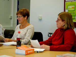 Group of women in classroom learning spanish