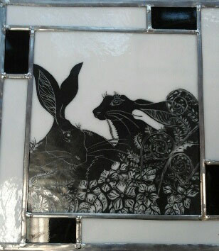Stained glass panel with rabbits