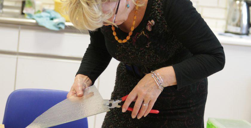 Woman cutting glass