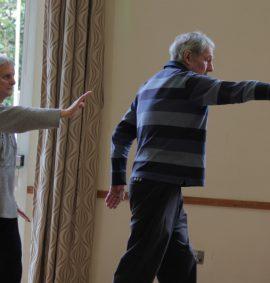 Group practising Tai Chi
