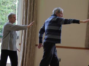 Group practising Tai Chi
