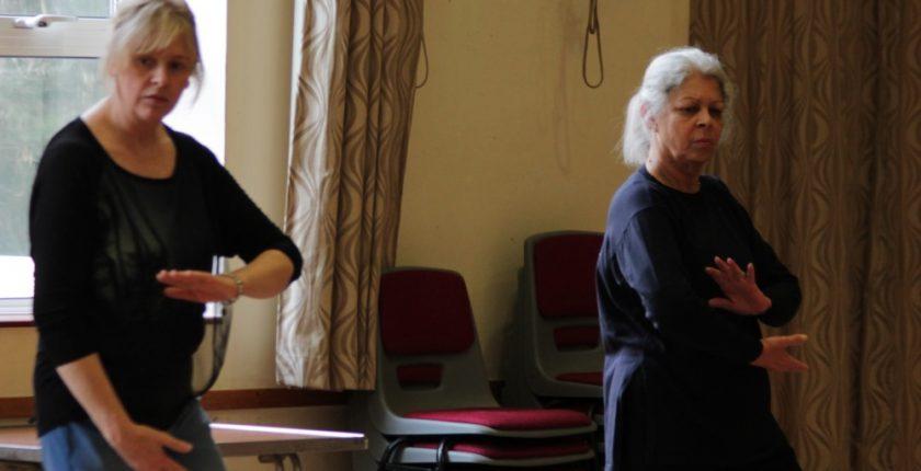 Two women practising Tai Chi