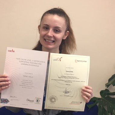 Young woman holding two certificates