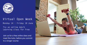 Woman practising a fitness class with a laptop