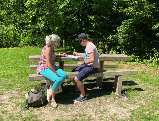 Tutor and learner sitting at bench