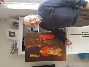 Man standing with his painting