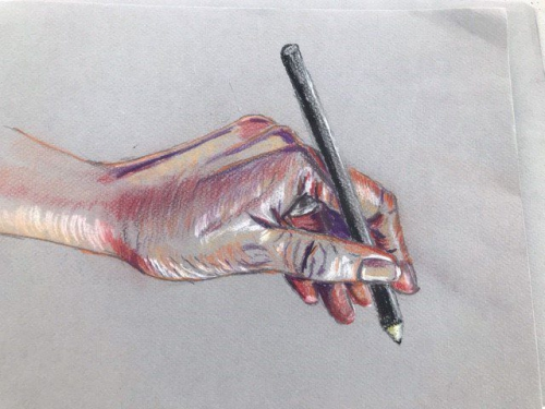 Drawing of a hand holding a pencil