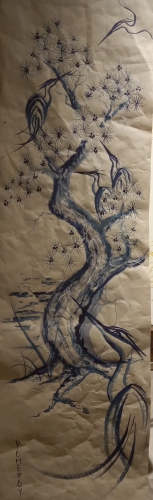 Drawing of Japanese birds and tree in blue on paper background