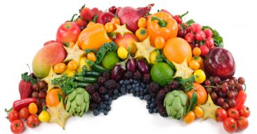 Fruit and vegetables laid out in rainbow shape
