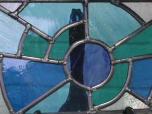 Blue and green stained glass window